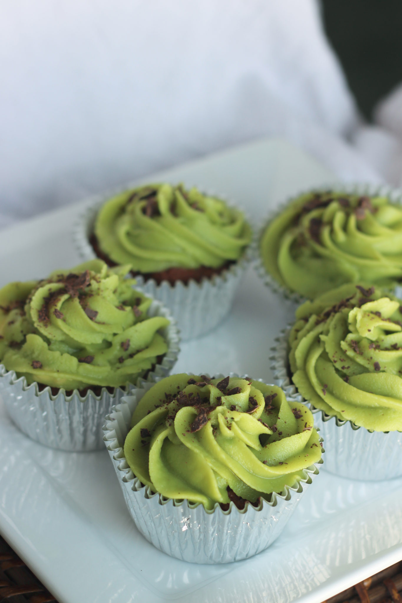 Chocolate Cupcakes with Green Mint Frosting and Shaved Chocolate garnish.